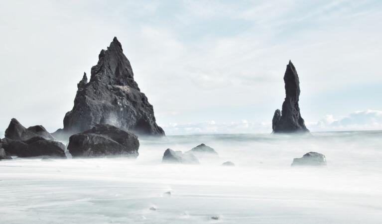 reynisdrangar Rock in the sea at Vik